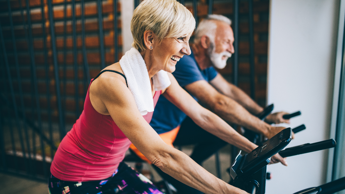 Two seniors exercising on stationary bikes wondering if Medicare Advantage is changing.