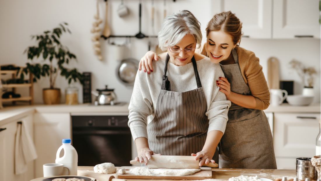 A mother and daughter baking together.
