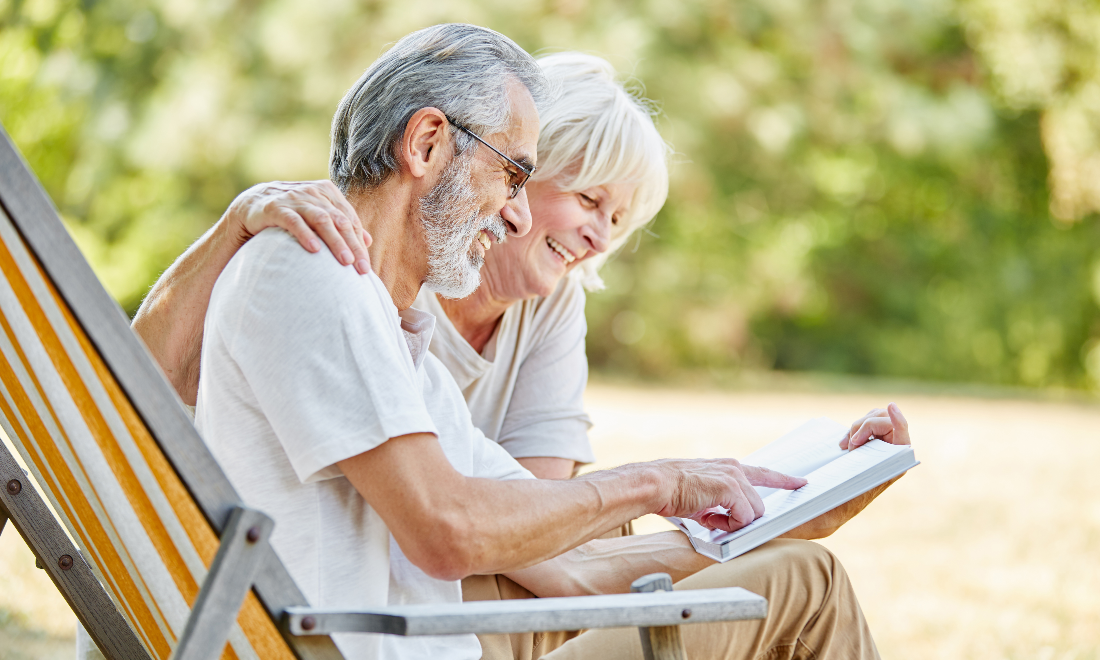 A senior couple read through the Medicare and You Handbook