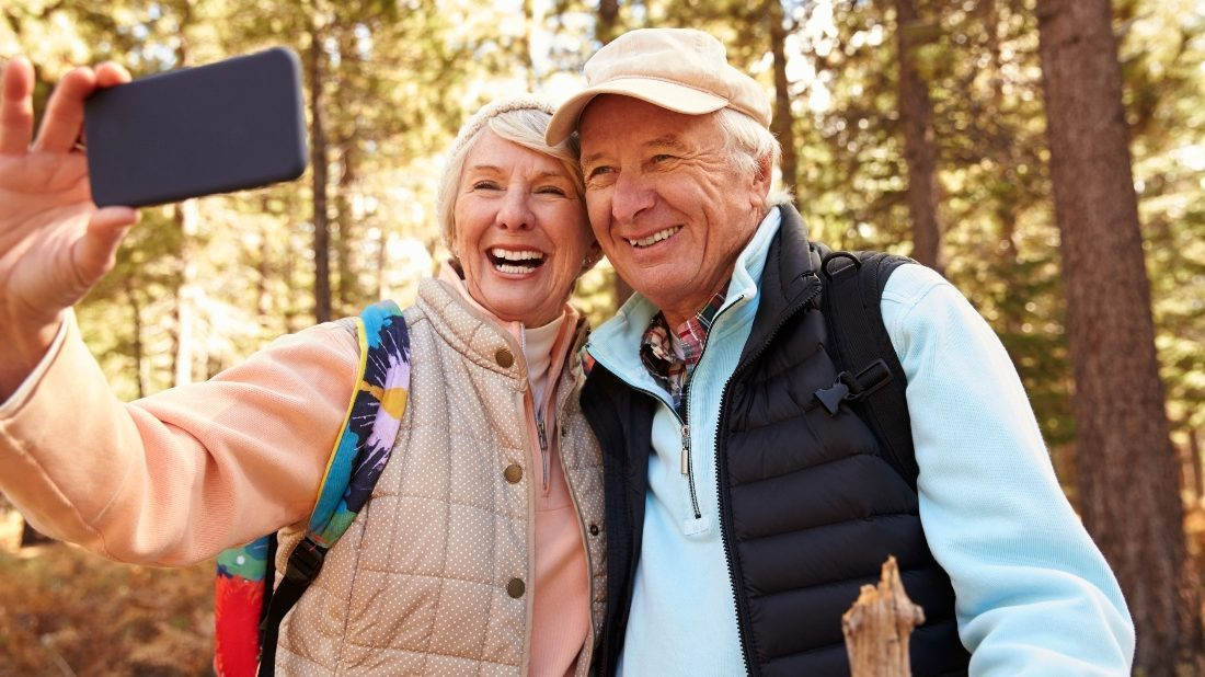 Two active seniors pause to smile for a